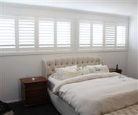 Plantation shutters in bedroom suite